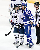 Jimmy Martin (Yale - 2), Jacques Lamoureux (Air Force - 21) - The Yale University Bulldogs defeated the Air Force Academy Falcons 2-1 (OT) in their East Regional Semi-Final matchup on Friday, March 25, 2011, at Webster Bank Arena at Harbor Yard in Bridgeport, Connecticut.