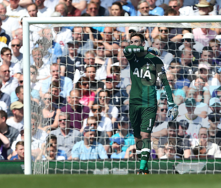 Tottenham's Hugo Lloris looks on dejected after conceding Southampton's opening goal during the Barclays Premier League match at the White Hart Lane Stadium.  Photo credit should read: David Klein/Sportimage