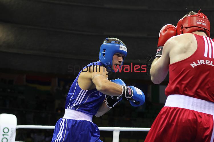 Delhi 2010 Commonwealth Games..Keiran Harding (Wales -Blue) v Eamonn O'Kane (Northern Ireland- Red).11.10.10.Photo Credit-Steve Pope-Sportingwales