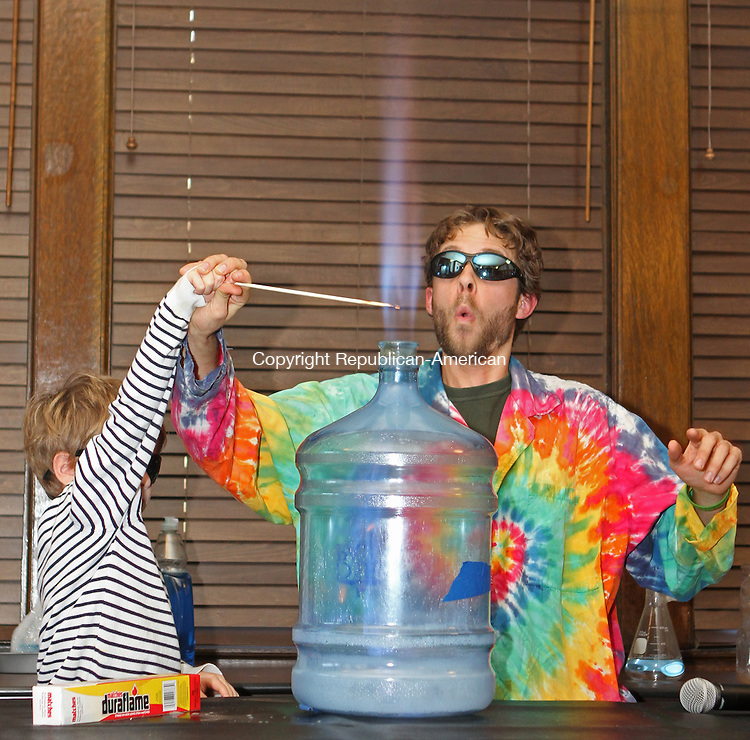 "Washington, CT-113013MK22 COUNTRYLIFE Ken Nicholas from Sciencetellers with the help from Arlo Ten-Hoeve ignites the horn of fire during ""Dragons and Dreams,"" a family program put on by the Sciencetellers at Gunn Memorial Library on Saturday afternoon. The presentation was a fairytale brought to life with exploding bottles, dry ice, popping bubbles and other fun interactive experiments.  Michael Kabelka / Republican-American"