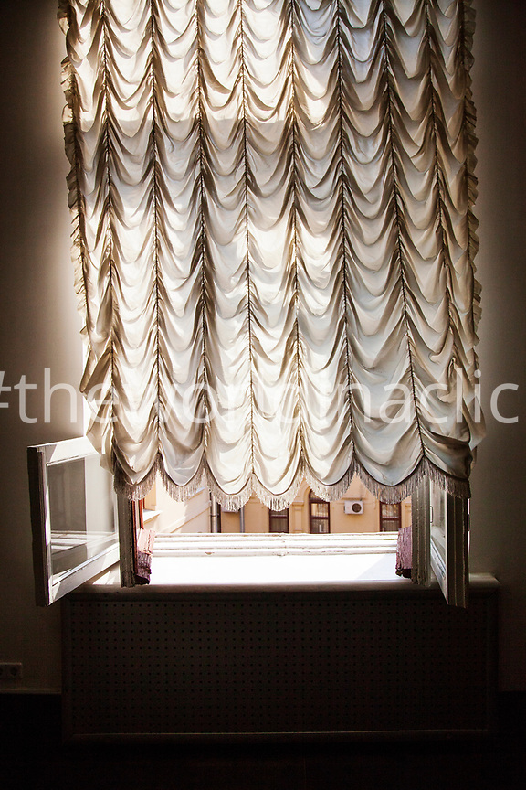 RUSSIA, Moscow. Window and curtain at the Polytechnic Museum.