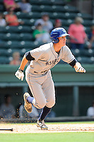 Right fielder Jordan Patterson (10) of the Asheville Tourists in a game against the Greenville Drive on Sunday, July 20, 2014, at Fluor Field at the West End in Greenville, South Carolina. Asheville won game one of a doubleheader, 3-1. (Tom Priddy/Four Seam Images)