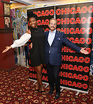 Brandy Norwood and Producer Barry Weissler attends the press photo call for her return to Broadway's 'Chicago' at Sardi's on August 16, 2017 in New York City.