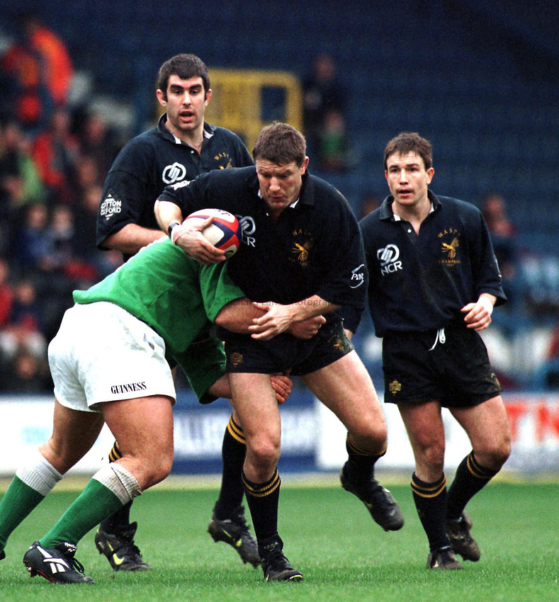 Photo. Richard Lane..Buster White tries to break through the Irish defence. Wasps v's London Irish. 15/3/98.