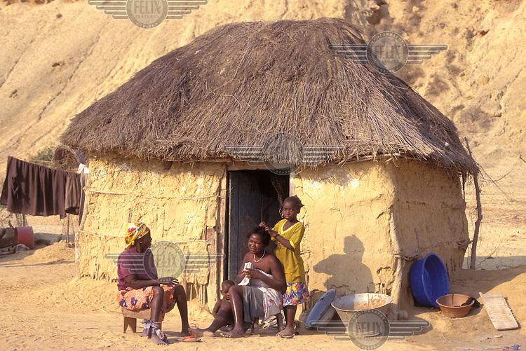 © Giacomo Pirozzi / Panos Pictures..ANGOLA..Family outside their home.