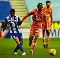 Blackpool's Nathan Delfouneso competes with Wigan Athletic's Sam Morsy<br /> <br /> Photographer Richard Martin-Roberts/CameraSport<br /> <br /> The EFL Sky Bet League One - Wigan Athletic v Blackpool - Tuesday 13th February 2018 - DW Stadium - Wigan<br /> <br /> World Copyright &not;&copy; 2018 CameraSport. All rights reserved. 43 Linden Ave. Countesthorpe. Leicester. England. LE8 5PG - Tel: +44 (0) 116 277 4147 - admin@camerasport.com - www.camerasport.com