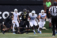 WINSTON-SALEM, NC - SEPTEMBER 13: Javonte Williams #25 of the University of North Carolina runs the ball during a game between University of North Carolina and Wake Forest University at BB