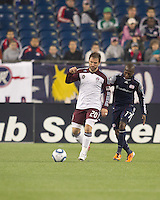 Colorado Rapids midfielder Jamie Smith (20) dribbles as New England Revolution midfielder Sainey Nyassi (17) closes. In a Major League Soccer (MLS) match, the New England Revolution tied the Colorado Rapids, 0-0, at Gillette Stadium on May 7, 2011.