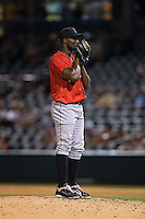 Indianapolis Indians relief pitcher Radhames Liz (37) looks to his catcher for the sign against the Charlotte Knights at BB&T BallPark on June 20, 2015 in Charlotte, North Carolina.  The Knights defeated the Indians 6-5 in 12 innings.  (Brian Westerholt/Four Seam Images)