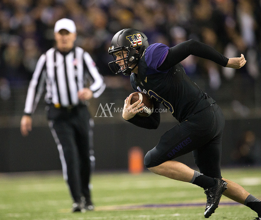 Jake Browning had to scramble quite a bit throughout the game.