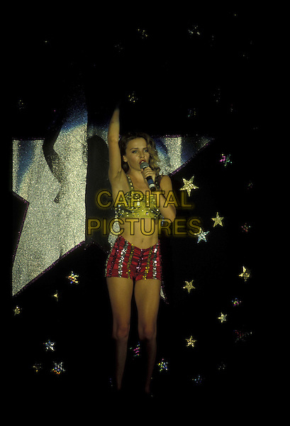 KYLIE MINOGUE.Ref:026.singing, stage, concert, live, music, belly, stomach, midriff, full length, full-length.*RAW SCAN- photo will be adjusted for publication*.www.capitalpictures.com.sales@capitalpictures.com.©Capital Pictures