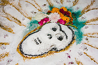 Oaxaca, Mexico, North America.  Day of the Dead Celebrations.  Sand Painting of a Skull, Cemetery Decoration in Memory of the Dead.  San Miguel Cemetery, Oaxaca.