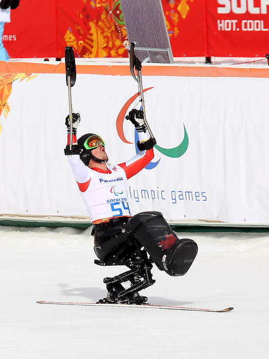 Sochi, Russia.08/03/2014. Canadian Josh Dueck wins silver in the mens sitting skiing downhill at the Rosa Khutor Alpine Centre during the 2014 Paralympic Winter Games.(Photo:Scott Grant/Canadian Paralympic Committee