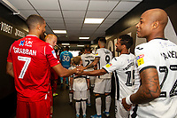 Lewis Grabban of Nottingham Forest shakes hands with Wayne Routledge of Swansea City during the Sky Bet Championship match between Swansea City and Nottingham Forest at the Liberty Stadium in Swansea, Wales, UK. Saturday 14 September 2019