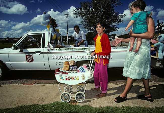 A poor white family receives food from the Salvation Army on December 25, 1996 in a poor white area in Krugersdorp, west of Johannesburg, South Africa. The Salvation Army gave out food and presents on Christmas day to formerly white Afrikaners that were protected by the old Apartheid regime. These people now have to share the resources in the country with a the black population since the democratic election in 1994......