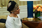 Queen Maxima of the Netherlands listens to United States President Barack Obama (unseen) and King Willem-Alexander of the Netherlands (unseen) during a meeting in the Oval Office of the White House in Washington, D.C. on June 1, 2015.<br /> Credit: Aude Guerrucci / Pool via CNP