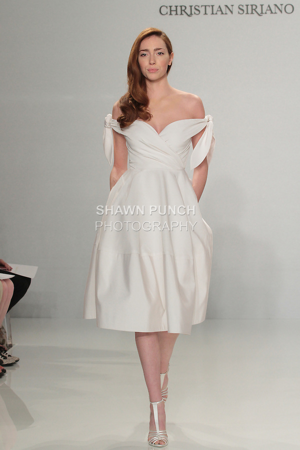 Model walks runway in an off-the-shoulder tie dress, from the Christian Siriano for Kleinfeld bridal collection, at Kleinfeld on April 18, 2016 during New York Bridal Fashion Week Spring Summer 2017.
