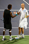 SHANGHAI, CHINA - OCTOBER 15:  Gael Monfils of France congratulates Ivan Ljubicic of Croatia after retiring of the match during day five of 2009 Shanghai ATP Masters 1000 at Qi Zhong Tennis Centre on October 15, 2009 in Shanghai, China. Photo by Victor Fraile / The Power of Sport Images