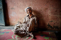 A Babaria man sits on the floor in a house in Panipat. <br /> <br /> The Babaria are a major source of illegally traded tiger parts since they used to hunt them when it was legal to do so and now sell them to traffickers.