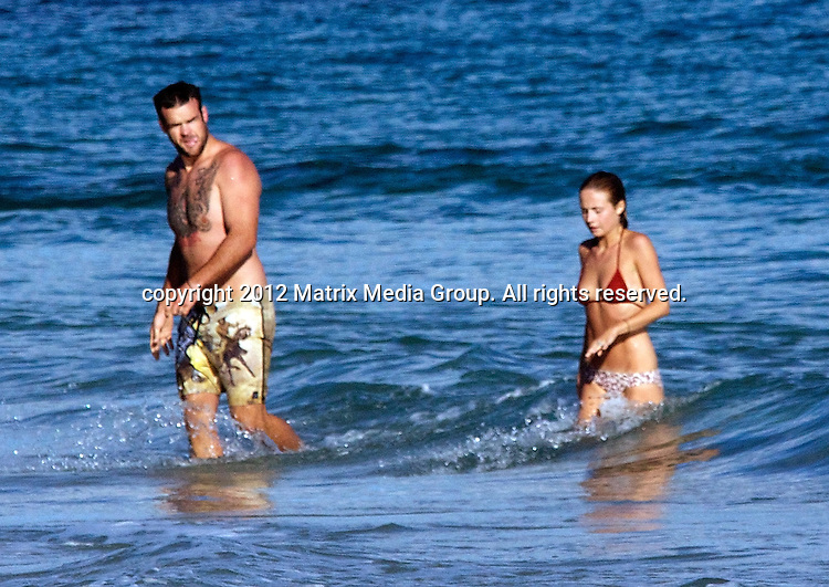 4/1/2012. Sydney, Australia...EXCLUSIVE..Former Roosters star Nate Myles and new wife Tessa James on enjoy Watego's Beach while on Honeymoon in Byron Bay.4/1/2012. Sydney, Australia...EXCLUSIVE..Former Roosters star Nate Myles and new wife Tessa James on enjoy Watego's Beach while on Honeymoon in Byron Bay...*No internet without clearance*.MUST CALL PRIOR TO USE ..02 9211-1088.Matrix Media Group.Note: All editorial images subject to the following: For editorial use only. Additional clearance required for commercial, wireless, internet or promotional use.Images may not be altered or modified. Matrix Media Group makes no representations or warranties regarding names, trademarks or logos appearing in the images.