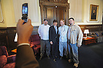 Illinois Governor Rod Blagojevich poses with members of his kitchen staff, who he promised raises, after speaking in his own defense at his impeachment hearing at the state capitol in Springfield, Illinois on January 29, 2009.