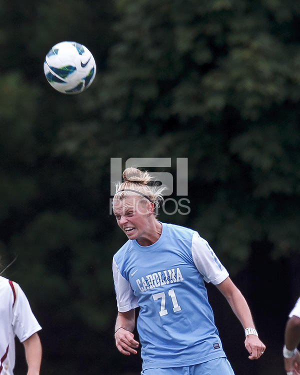 University of North Carolina defender Hanna Gardner (71) heads the ball.   University of North Carolina (blue) defeated Boston College (white), 1-0, at Newton Campus Field, on October 13, 2013.