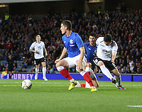 Ross Perry thwarts Nicky Clark in the Rangers v Queen of the South Quarter Final match in the Ramsdens Cup played at Ibrox Stadium, Glasgow on 18.9.12.