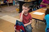 MR / Schenectady, New York. Yates Arts-in-Education Magnet School (urban public school). First grade classroom. Portrait of pensive child (boy, 6) in classroom. MR: Woo4. ID: AM-g1w. © Ellen B. Senisi.