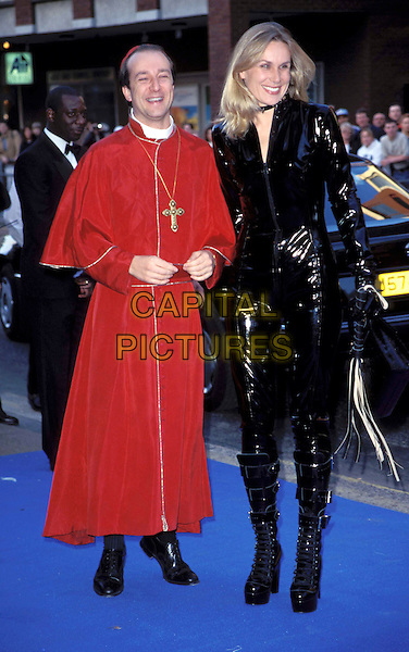 PAUL MCKENNA & CLAIRE STAPLES..Elton John's 50th Birthday Party..Ref: 4792..magician, fancy dress costume, priest, cat woman, leathers, crucifix, whip..www.capitalpictures.com..sales@capitalpictures.com