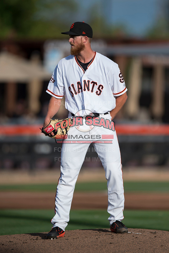 San Jose Giants starting pitcher Conner Menez (34) looks to his catcher for the sign during a California League game against the Modesto Nuts at San Jose Municipal Stadium on May 15, 2018 in San Jose, California. Modesto defeated San Jose 7-5. (Zachary Lucy/Four Seam Images)