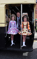 St Patricks Parade Birmingham  11th Mar 07.Dancers Sion McCarron and Leah Skerrett with their uncle Driver Bernard Larkin on the boarding platform of a vintage WMT  bus