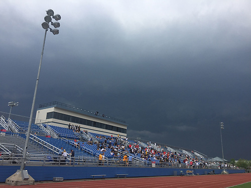 Ominous skies loom above Mitchel Athletic Complex during the Nassau-Suffolk CHSAA varsity boys lacrosse Class AA final between St. Anthony's and Chaminade on Tuesday, May 15, 2018. The game went to halftme tied 8-8 when a prolonged lightning storm forced a postponement.