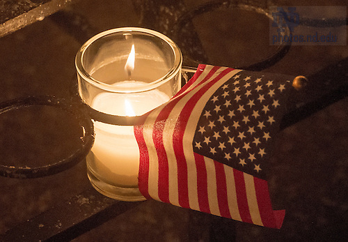 Sep. 12, 2014; Grotto Candles and U.S. Flag. (Photo by Matt Cashore/University of Notre Dame)
