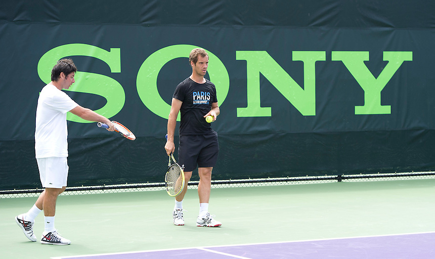 Richard Gasquet (FRA) practices with fellow Frenchman Gael Monfils (not shown) days before his opening round match <br /> <br /> Photographer Andrew Patron<br /> <br /> Tennis - Sony Open Tennis - ATP World Tour Masters 1000 - Day 2 - Tuesday 18th March 2014 - Tennis Center at Crandon Park Key Biscayne, Miami, Florida USA<br /> <br /> &copy; CameraSport - 43 Linden Ave. Countesthorpe. Leicester. England. LE8 5PG - Tel: +44 (0) 116 277 4147 - admin@camerasport.com - www.camerasport.com