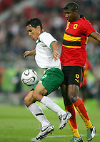 Carlos Salcido (3) of Mexico shields the ball from Loco (20) of Angola. Mexico and Angola played to a 0-0 tie in their FIFA World Cup Group D match at FIFA World Cup Stadium, Hanover, Germany, June 16, 2006.
