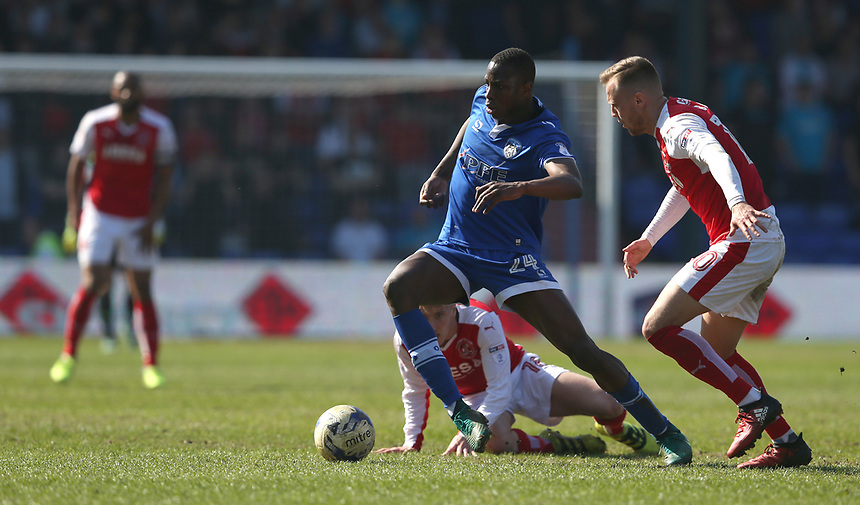 Oldham Athletic's Ousmane Fane battles with Fleetwood Town's George Glendon (left, grounded) and David Ball<br /> <br /> Photographer Stephen White/CameraSport<br /> <br /> The EFL Sky Bet League One - Oldham Athletic v Fleetwood Town - Saturday 8th April 2017 - SportsDirect.com Park - Oldham<br /> <br /> World Copyright &copy; 2017 CameraSport. All rights reserved. 43 Linden Ave. Countesthorpe. Leicester. England. LE8 5PG - Tel: +44 (0) 116 277 4147 - admin@camerasport.com - www.camerasport.com