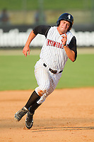 Brady Shoemaker #21 of the Kannapolis Intimidators hustles towards third base against the Hagerstown Suns at Fieldcrest Cannon Stadium August 8, 2010, in Kannapolis, North Carolina.  Photo by Brian Westerholt / Four Seam Images