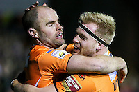 Picture by Alex Whitehead/SWpix.com - 06/03/2015 - Rugby League - First Utility Super League - Castleford Tigers v Wigan Warriors - the Mend A Hose Jungle, Castleford, England - Castleford's Liam Finn (L) is congratulated on his try by Oliver Holmes (R).