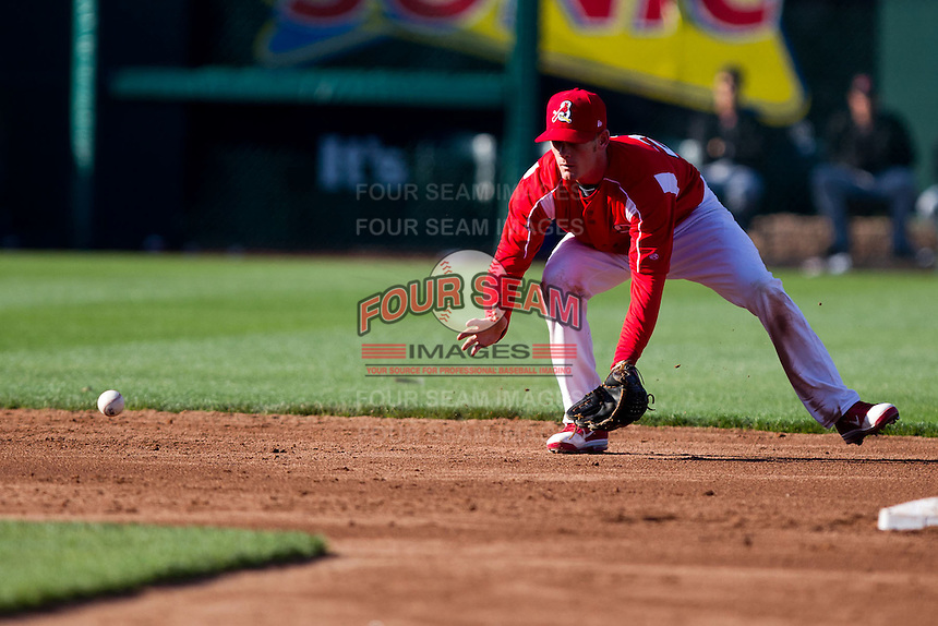 Ryan Jackson (23) of the Springfield Cardinals fields a ground ball during a game against the Frisco RoughRiders on April 16, 2011 at Hammons Field in Springfield, Missouri.  Photo By David Welker/Four Seam Images