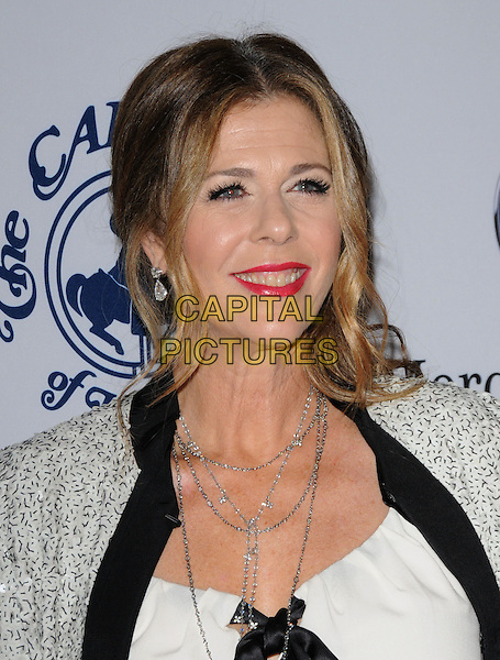 RITA WILSON .at The 32nd Annual Carousel of Hope Ball held at The Beverly Hilton hotel in Beverly Hills, California, USA, .October 23rd 2010..portrait headshot red lipstick smiling black silver white necklace jacket                                        .CAP/RKE/DVS.©DVS/RockinExposures/Capital Pictures.
