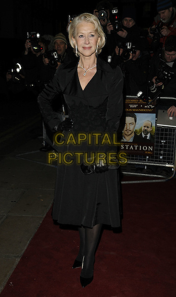 DAME HELEN MIRREN .The UK Premiere of 'The Last Station' at The Curzon Mayfair Cinema, London, England..January 26th 2010.full length black coat velvet clutch bag gloves hand on hip.CAP/CAN.©Can Nguyen/Capital Pictures.