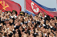 "North Koreans wave clap as North Korean leader Kim Jong Un, unseen waves from a balcony at the end of a mass military parade in Pyongyang's Kim Il Sung Square to celebrate 100 years since the birth of his grandfather, and North Korean founder, Kim Il Sung on Sunday, April 15, 2012. ""Inside DPRK"""
