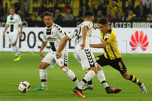 23.09.2016. Dortmund, Germany. German Bundesliga Football. Borussia Dortmund versus SC Freibrug.   Manuel Gulde (SC Freiburg), Emre Mor (BVB Borussia Dortmund), Vincenzo Grifo (SC Freiburg)