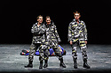"""London, UK. 12.03.2019. Simon McBurney's production of Mozart's """"The Magic Flute"""" returns to English National Opera. Set design by Michael Levine, costume design by Nicky Gillibrand, with revival lighting design by Mike Gunning, and video design by Finn Ross. Picture shows: Samantha Price (Second Lady), Susanna Hurrell (First Lady), Katie Stevenson (Thrd Lady), Rupert Charlesworth (Tamino) Photograph © Jane Hobson."""