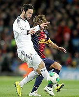 FC Barcelona's Carles Puyol (r) and Real Madrid's Gonzalo Higuain during Copa del Rey - King's Cup semifinal second match.February 26,2013. (ALTERPHOTOS/Acero) /Nortephoto