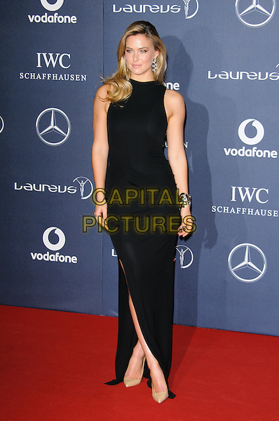 Bar Refaeli.Arrivals at the Laureus 2012 World Sports Awards held at the Queen Elizabeth II Centre, London, England..February 6th, 2012.full length black dress sleeveless split split.CAP/CJ.©Chris Joseph/Capital Pictures.