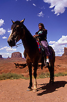 India horse rider in Monument Valley National Park and navaho Indian reservation,  Utah, USA