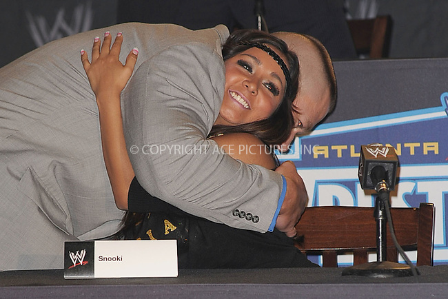WWW.ACEPIXS.COM . . . . . .March 30, 2011...New York City...Snooki and John Cena attend the WWE  Wreslemania XXVII Press Conference at the Hard Rock Cafe on  March 30, 2011 in New York City....Please byline: KRISTIN CALLAHAN - ACEPIXS.COM.. . . . . . ..Ace Pictures, Inc: ..tel: (212) 243 8787 or (646) 769 0430..e-mail: info@acepixs.com..web: http://www.acepixs.com .