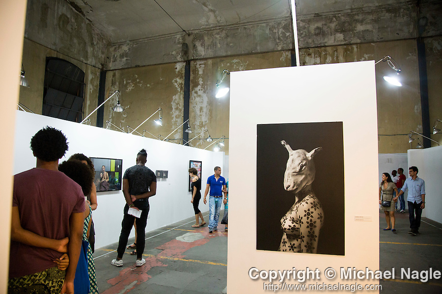 HAVANA, CUBA -- MARCH 22, 2015:   People attend a photography exhibition at the Fábrica de Arte Cubano in Havana, Cuba on March 22, 2015. Photograph by Michael Nagle