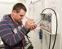 Student electrician installing a fusebox, Able Skills, Dartford, Kent.